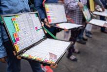 Street Vendor Selling Thai Lottery.