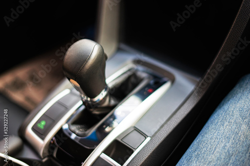 Fototapeta close up of an automatic gear box of a car or stick shift transmission, with mod