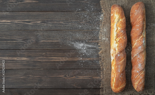Fresh French baguette made from white flour cools after baking Canvas Print