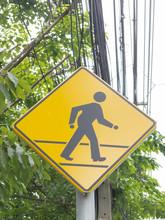 Pedestrian Crossing Sign Over Yellow Street.