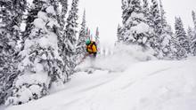A Snowboarder Flies, Jumping O...