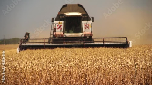 Aufkleber - Blurred сombine harvester for harvesting wheat. Slow motion