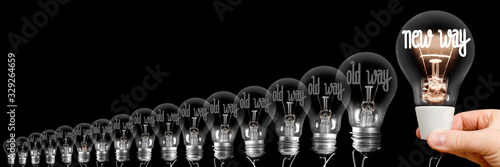 Photo Light Bulbs with New and Old Way Concept