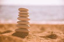 Balanced Stone Pyramid On Sand...