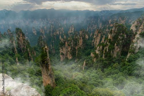 Obraz Foggy panorama of mountain range in Yellow Stone Stronghold (Huangshi Zhai) in Yuanjiajie Scenic Area , Zhangjiajie National Park, China - fototapety do salonu