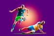 Leinwandbild Motiv colourful professional soccer players isolated over purple background