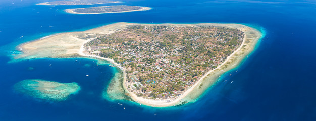Panoramic aerial view of a beautiful tropical island surrounded by coral reef (Gili Air, Indonesia)