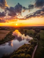 Jezioro w Wielkopolsce z lotu ptaka, o zachodzie słońca