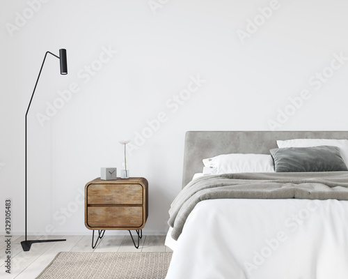 obraz dibond Bright bedroom with a wooden bedside table and a stylish floor lamp
