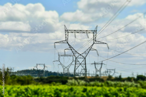 Fotografia electricity pylons in field, photo as a background
