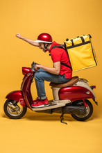 Side View Of Delivery Man With Backpack On Scooter On Yellow Background