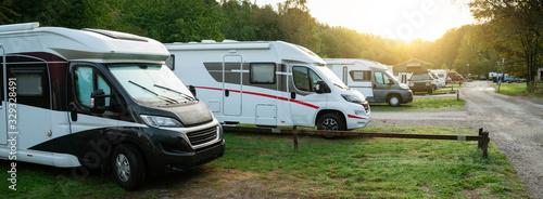 Fotografie, Obraz Camper vans in a camping park