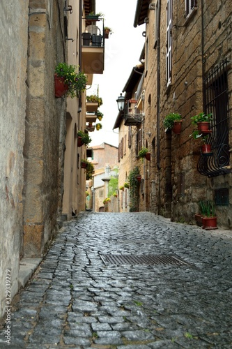 Colorful houses in the old medieval street in Italy