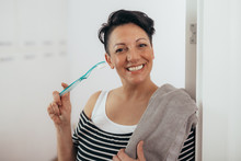 Woman Holding Toothbrush And T...