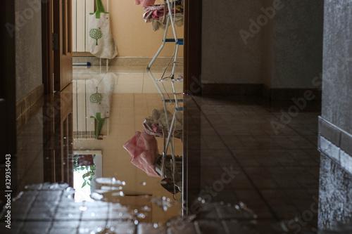 Fototapeta Water damage due a broken pipe. Moisture problem and wet floor. Horizontal, selective focus obraz