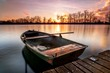 canvas print picture - boat on lake at sunset