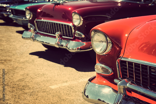 Fototapeta classic vintage cars parked in a row