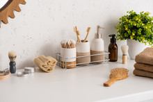 Shelf With Hygiene Objects And Beauty Products With Flowerpot In Bathroom, Zero Waste Concept