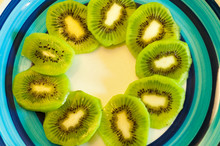Slices Of A Kiwi On A Colorful...