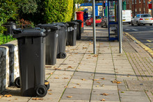 A Row Of Black Wheelie Bins Ou...