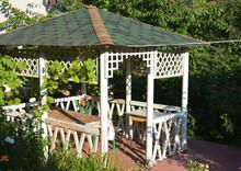 Cozy White Wooden Gazebo Or Pergola Design. Vinyl Garden Octagonal Gazebo In The Corner Of A Yard.