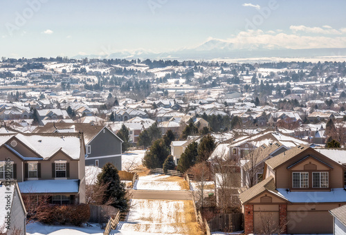 Colorado Living. Centennial, Colorado - Denver Metro Area Residential Winter Panorama with the view of a Front Range mountains on the distance