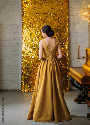 Young retro beautiful Great Gatsby woman turned stands backdrop sparkling golden screen piano Wallpaper Mural