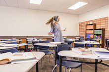 School Girl Listening To Music And Dancing In Classroom . Red Lodge, Montana, USA