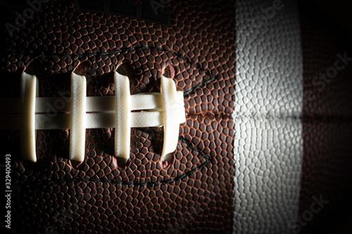 Obraz Close-up of an American football on black background - fototapety do salonu
