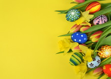 Happy Easter - Painted Eggs And Daffodils On Colored Background