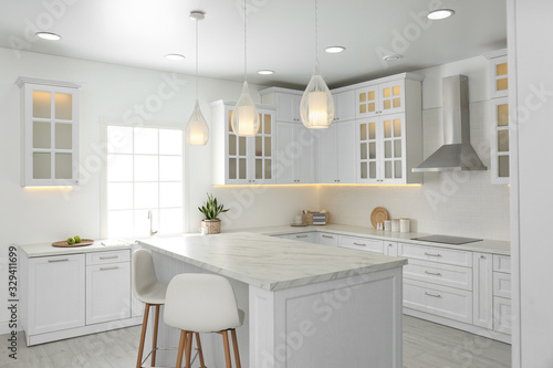 Fototapeta Beautiful kitchen interior with new stylish furniture obraz