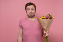 Man Asking For Forgiveness Feeling Sorry Standing With Flower Bouquet