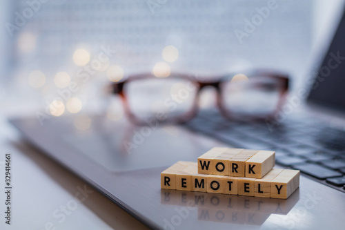 Work Remotely concept to suggest working anywhere anytime with laptop and glasse Wallpaper Mural