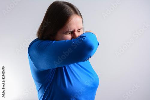Fényképezés Unhappy woman Cough into her elbow, not her hand