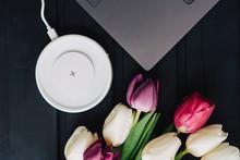 A Bouquet Of Tulips, A Laptop ...