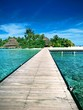 Beautiful paradise wooden walkway with island in the background