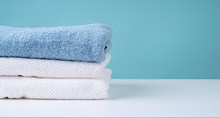 Stack Of Clean Towels On Blue Background