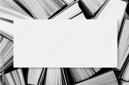 Photo A black and white image of hardback books or textbooks with blank space