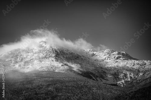 Winter, windblown, snow capped peak in black and white Billede på lærred