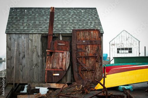 Fototapeta Weathered wood shack on Gloucester dock