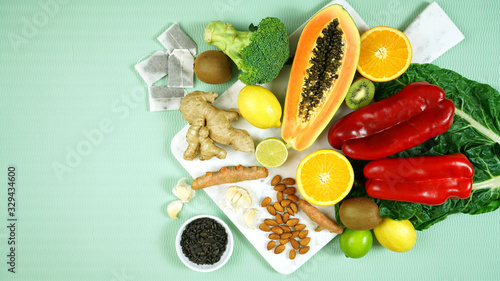 fototapeta na drzwi i meble Foods that boost the Immune System. Citrus, red bell peppers, broccoli, garlic, ginger, spinach, almonds, turmeric, green tea, papaya, kiwi fruit, poultry and sunflower seeds. Negative copy space.