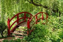 Red Wodden Bridge In A Park / ...