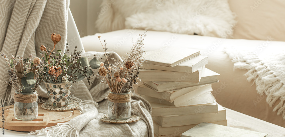 Fototapeta Home interior with books and dried flowers.