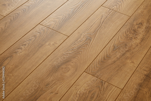 Obraz Wooden natural texture. New parquet blank. Wooden laminate floor boards background image. Home decor. - fototapety do salonu