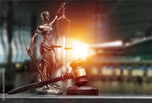 Statue of the lady of justice with scales and gavel on the desk Canvas Print