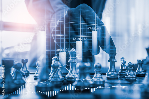 Fototapeta Chess game on chess board on stock market or forex trading graph chart for financial investment concept. Economy trends for digital business marketing strategy analysis. Abstract finance background. obraz