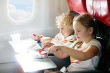 Child In Airplane. Kids Fly. C...