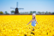 Kids In Tulip Flower Field. Wi...