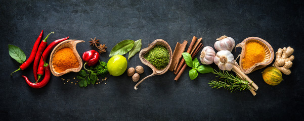 Various herbs and spices on dark background