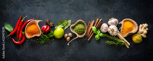 Fototapety do kuchni  various-herbs-and-spices-on-dark-background